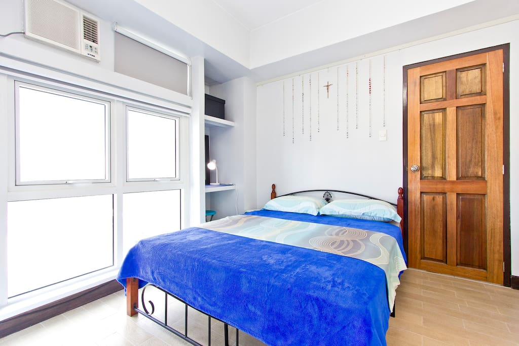 Air-conditioned Bedroom: Queen size steel and wooden frame with 8 inch ergonomic mattress