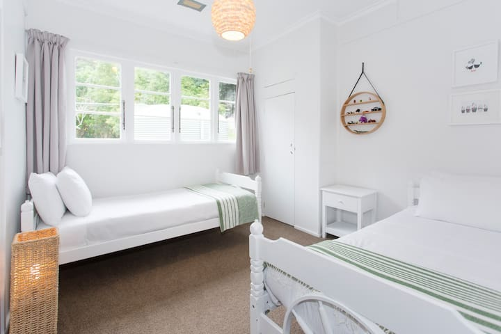 Bedroom two with two single beds and quality linen