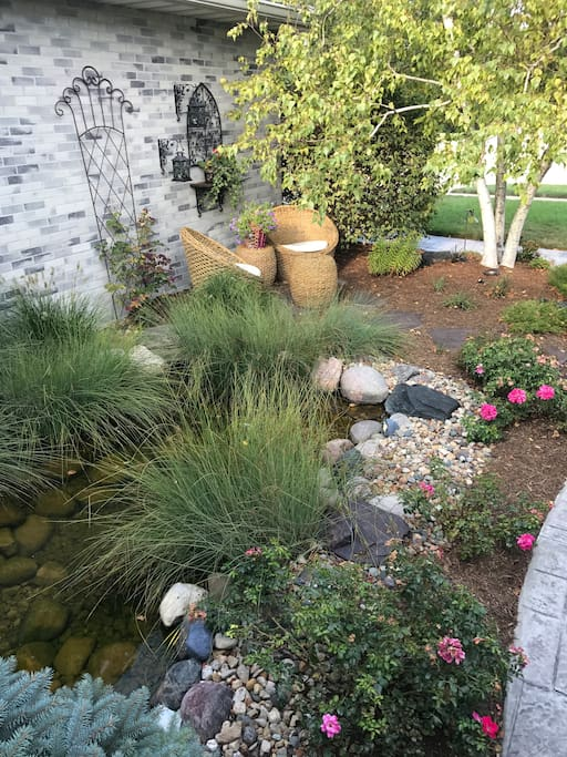 Enjoy a quiet seating area with pond