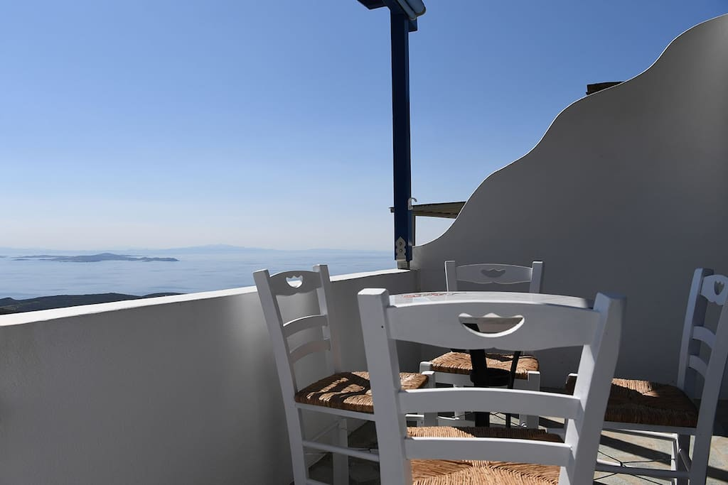 Marble table seating 4, view of Aegean sea