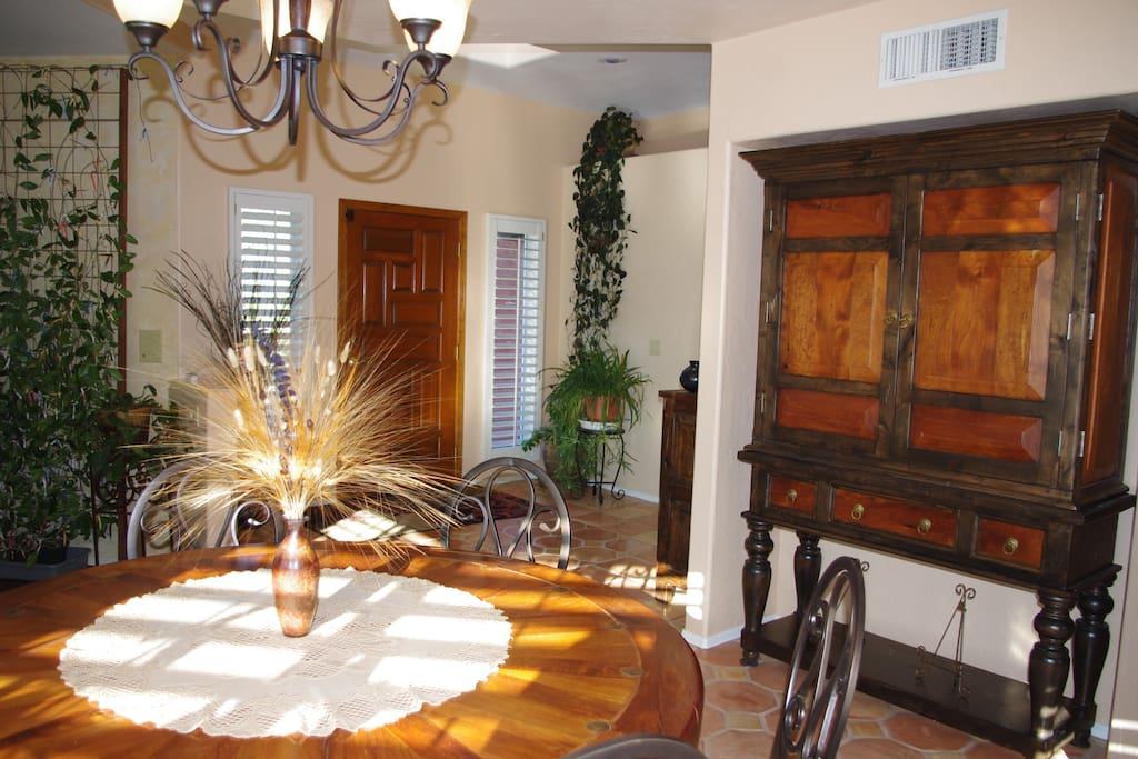 The formal dining room and other rooms feature furniture from old-world Mexico and South America.