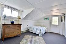 bedroom in boathouse with a double bed