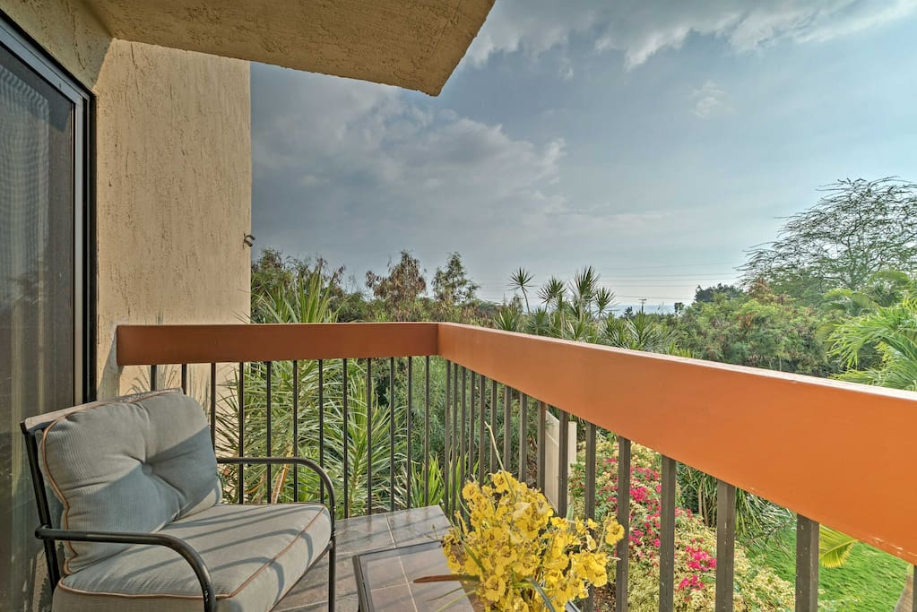 Relish the tropical foliage from the private balcony.