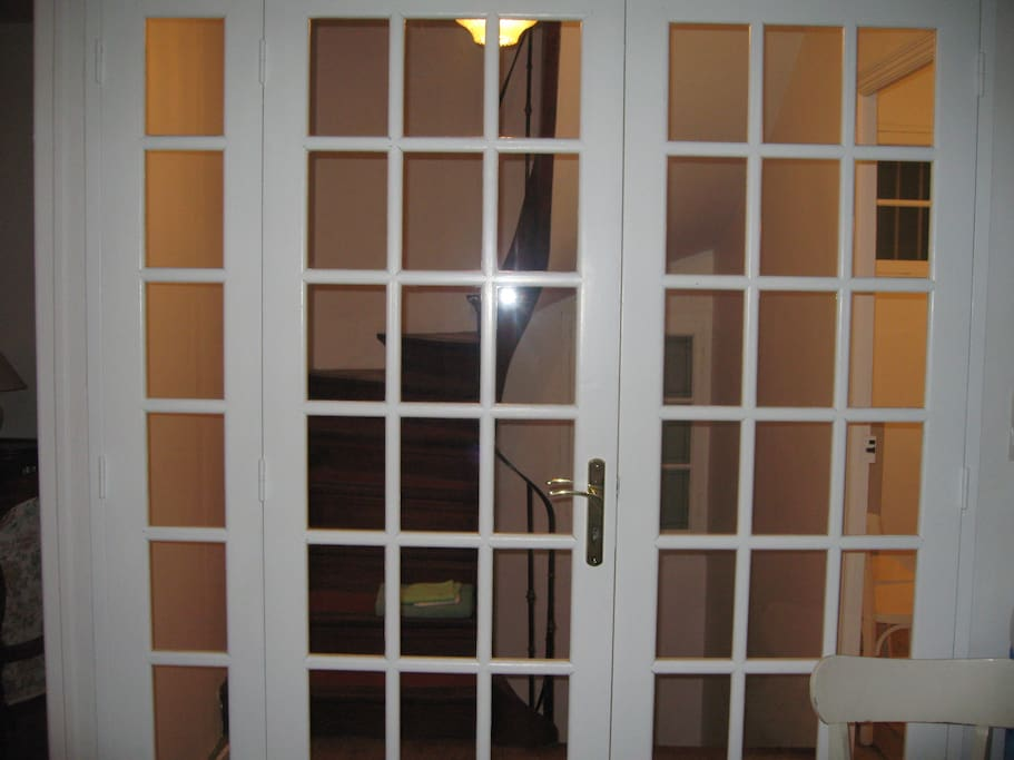 Double door between kitchen and stairs to the 2nd floor where there are 2 bedroom, bath/toilet,