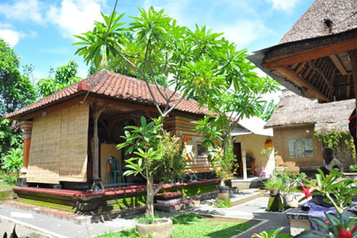 Our house is traditional with gardens and house temple.