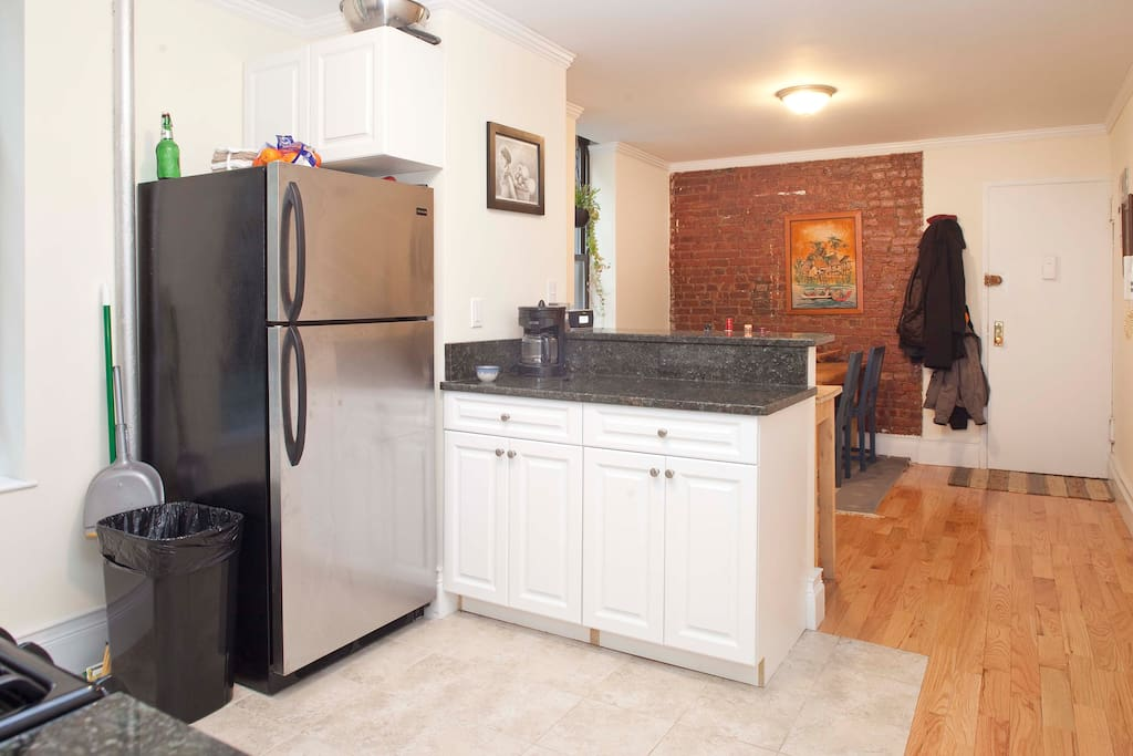 Our apartment was renovated in the fall and includes brand new hardwood floors throughout, stainless steel appliances, and granite counters. The kitchen is huge, has a ton of counter space, and is fully stocked with all the appliances you need.
