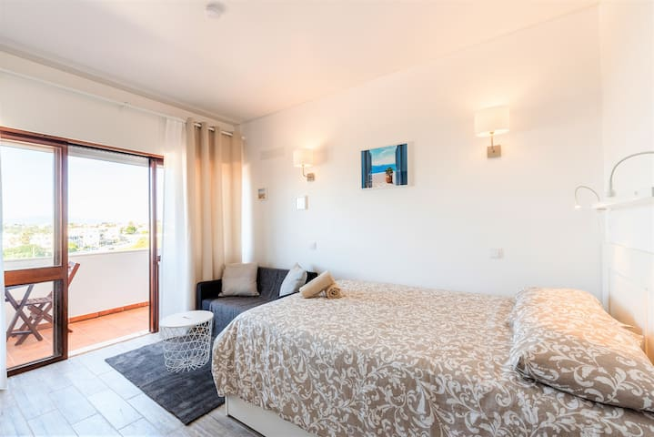 Double Bed, Living Aea and Balcony Sight - comfortable environment