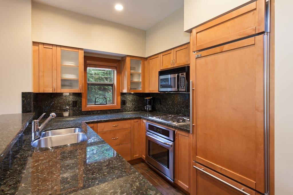 The beautiful kitchen is decked out with stainless steel appliances