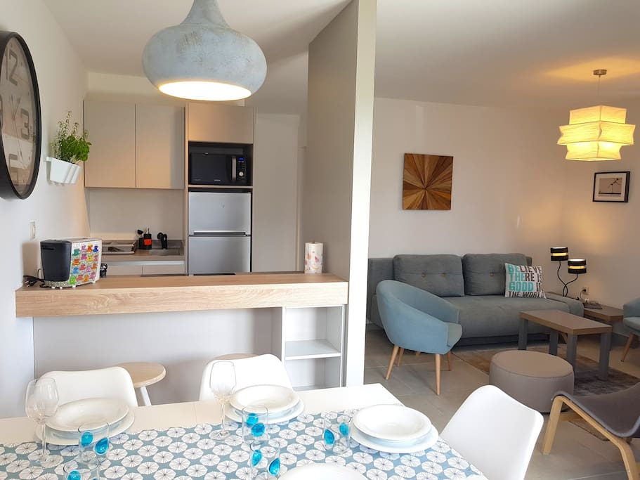 living space with fully equipped kitchen area on the ground floor