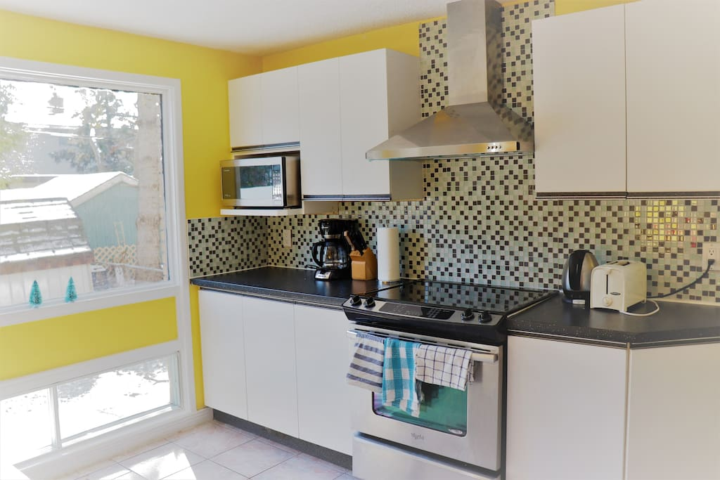 Kitchen - *New updated photo to come.* Enjoy our stocked kitchen with new stainless steel range and oven, and island style stainless steel range hood.  Dishwasher, toaster oven, microwave, fridge and freezer, programmable coffee maker, waffle maker, Magic Bullet etc.