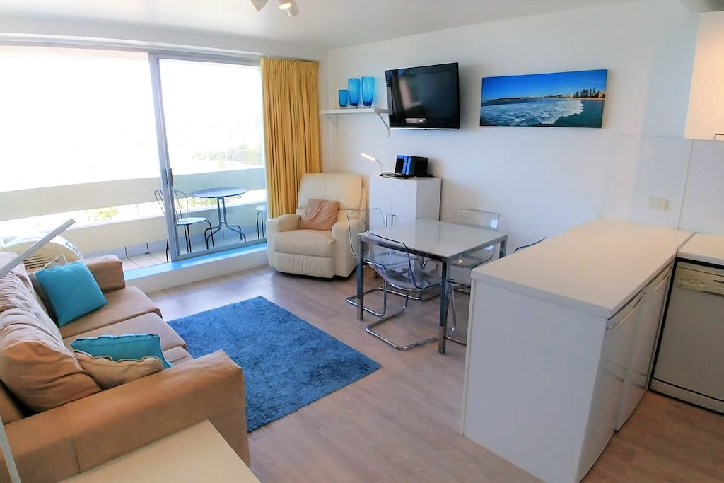 Plenty of space to relax and dine in the living room or on the balcony