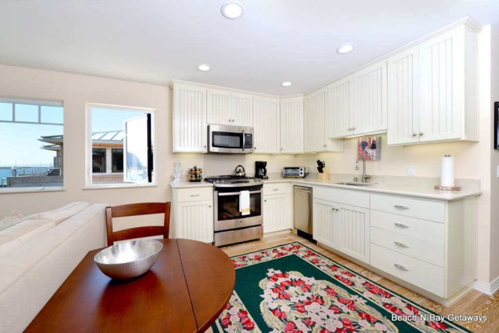 The kitchen has high-end appliances and everything you need to cook a nice meal.