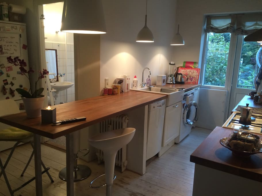 Dining area which you enter direct from the stairway. The kitchen is equipped with a small dishwasher, normal washing machine. Hood and gas cooker with four gas hobs and integrated electric oven.