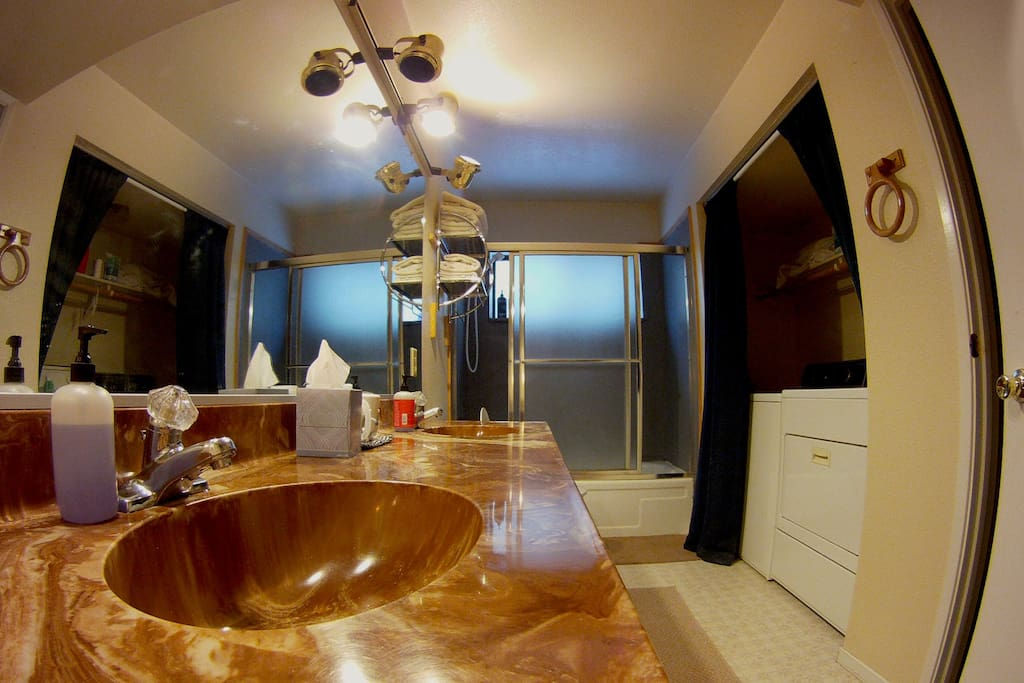 includes private bathroom with 2 sinks, shower/bath and washer/dryer