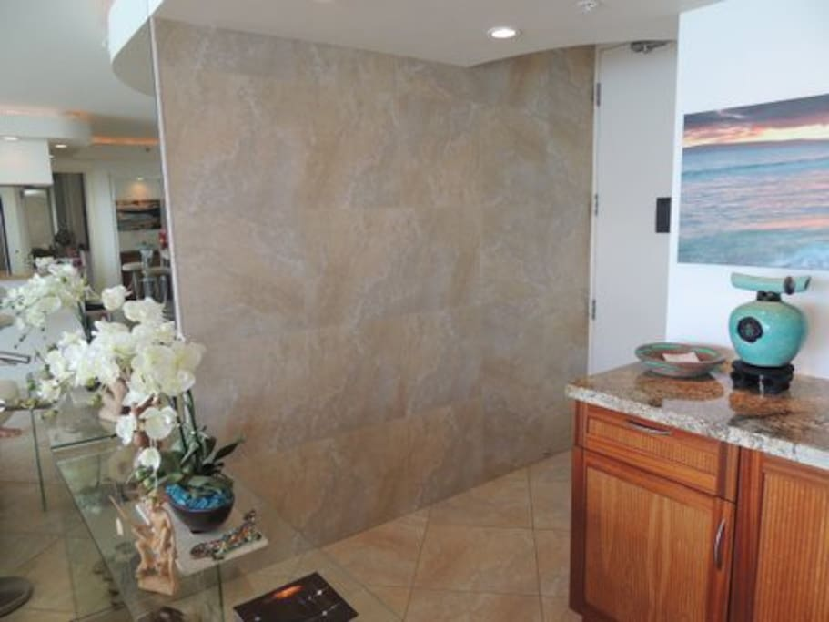 Travertine wall in the entry way, sculpted ceilings, special lighting through out.