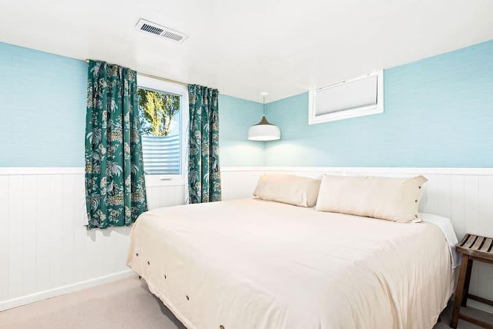 Basement bedroom, king bed, dresser and closet