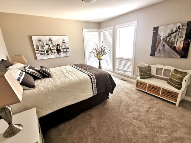 This cozy bedroom has the best sunrise view in the whole house! It is accessed from the main floor.  1 queen bed 1 closet View of Chief Mountain. Full private bathroom (with personal key) access in the hallway.