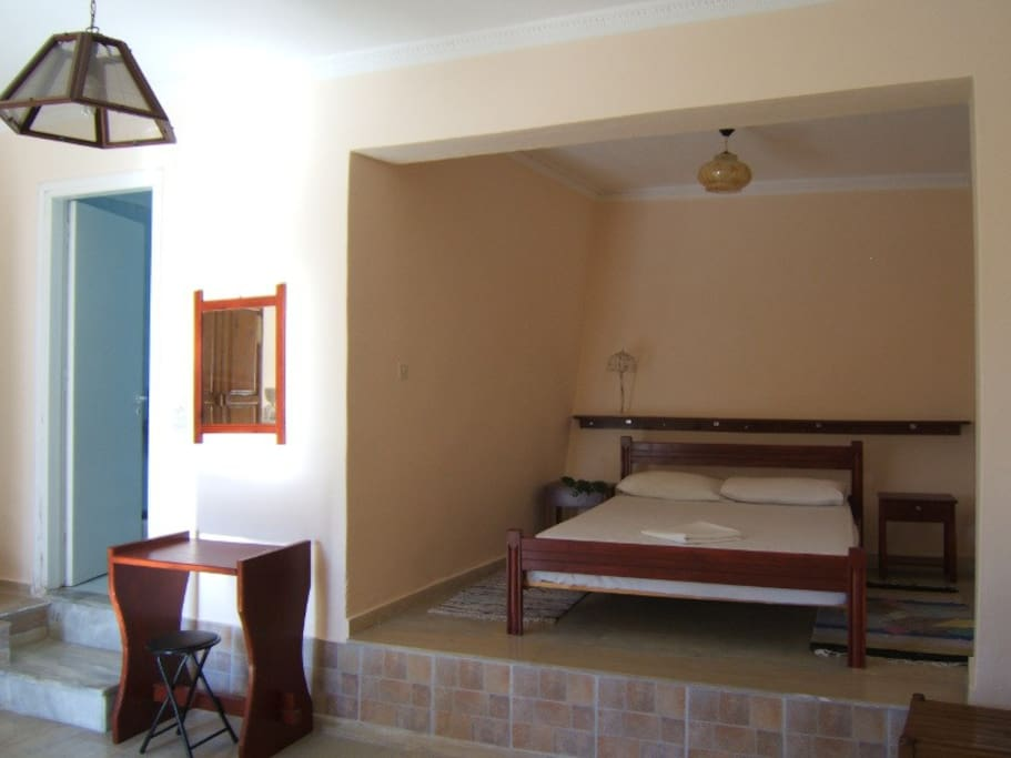 double bed for the parents, has a curtain that separates it from the rest of the apartment