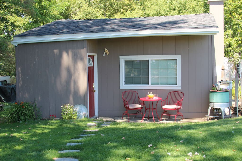 Cottage front yard on one acre property with  private pathway and parking pad