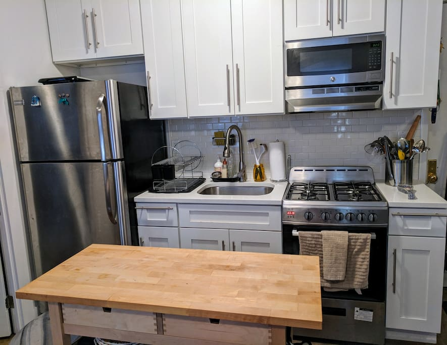 Fully stocked kitchen features new stainless steel appliances.
