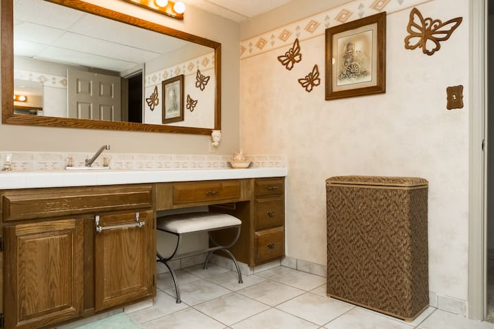 Very spacious shared bathroom with dressing area and shower.