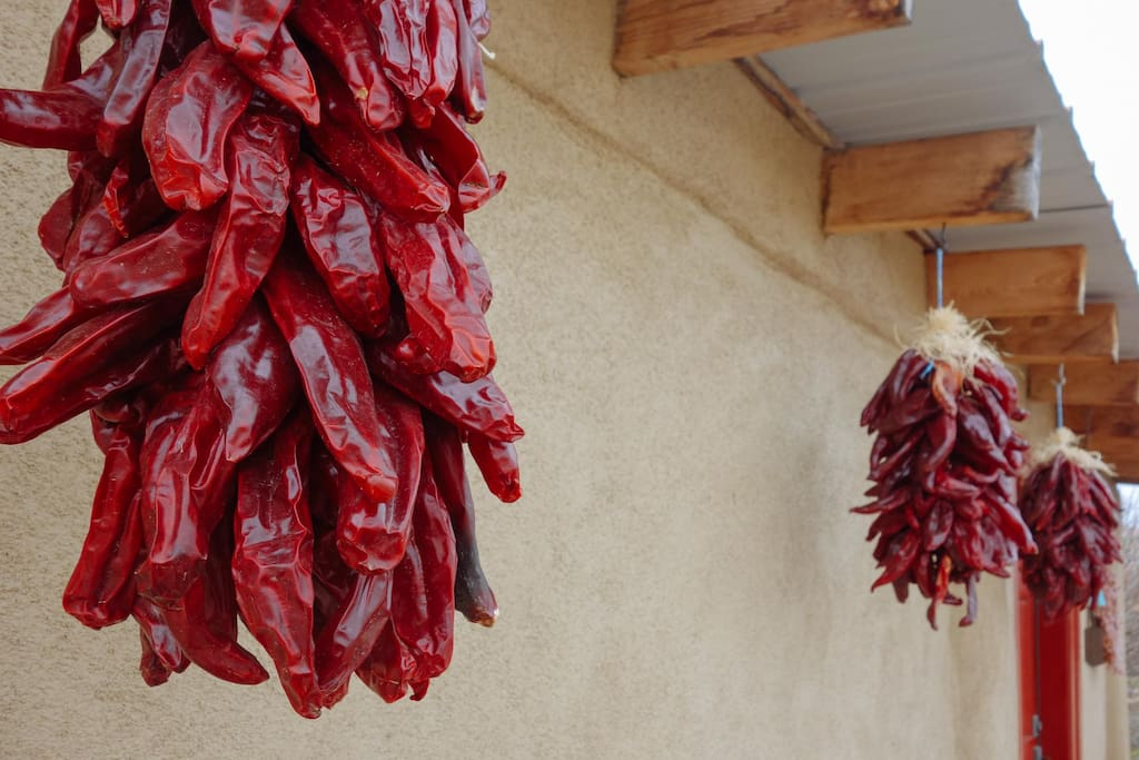 New Mexican Red Chile Ristras welcome you to the Red Door Casita.