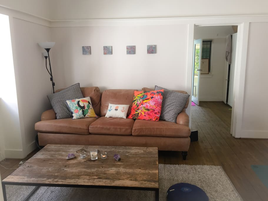 Cosy large couch, large table great for working on your laptop.  balcony door and wondows offer fresh air and natural light.