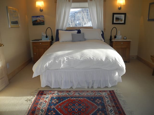 Main bedroom suite with private deck and own bathroom and walk in closet are on entire third floor of the home. Expansive views.