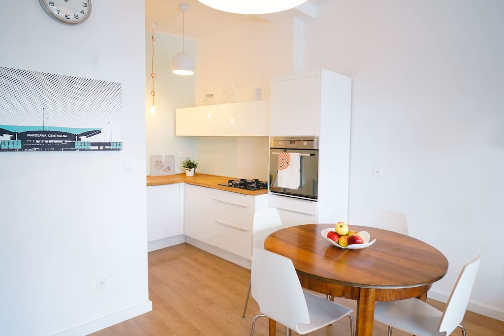 Sunny and warm kitchen with a table for 4. Fully equipped with everything you might need to prepare tasty meal.