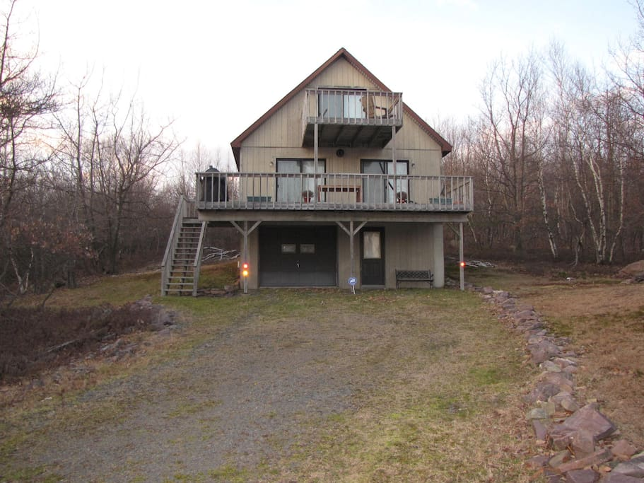 Our home sits on an acre of land and can accommodate several cars in the driveway.