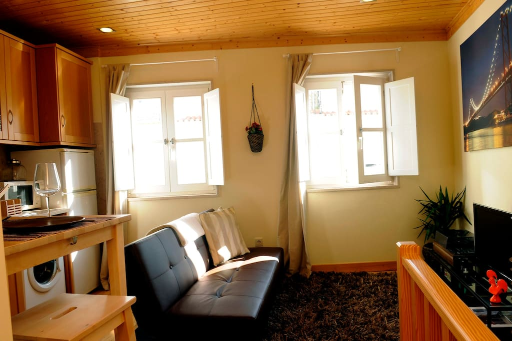 Living room with two windows that give directly to the street