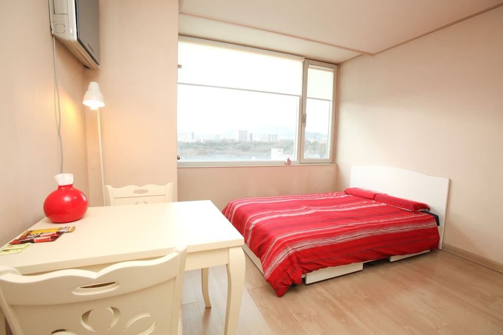 Clean and cozy White & Red color based room with interior light, big window