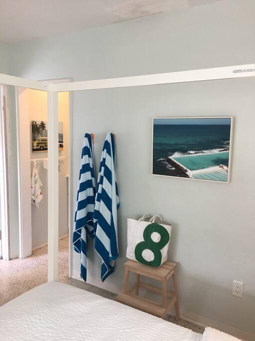 Big fluffy beach towels, beach chairs, umbrella and a cooler.