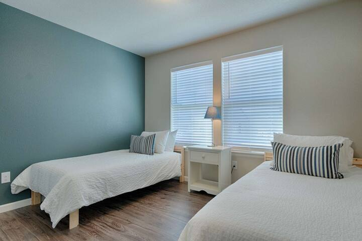 Two twin beds located in the second bedroom on the main level of the home.