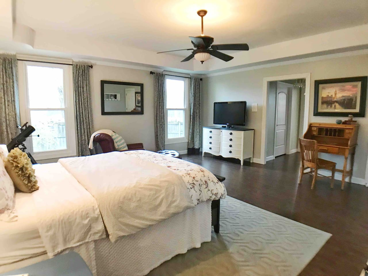Large, spacious room with queen bed, writing desk, leather recliner, and Apple TV