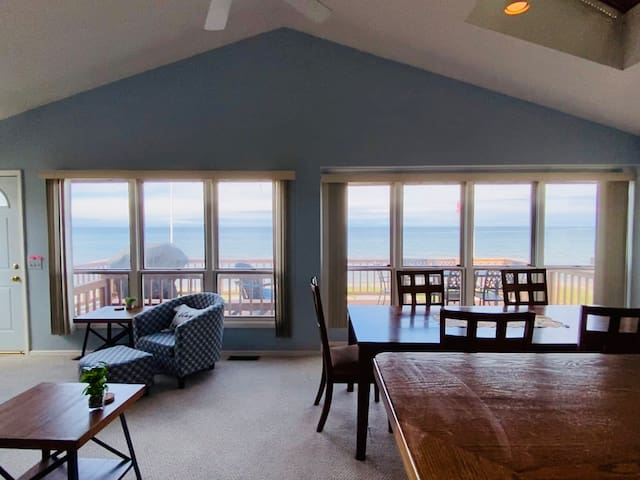 After going up the stairs, you will enter the Great Room on the second floor with the living area, kitchen and dining area, and of course the stunning view of Lake Ontario.