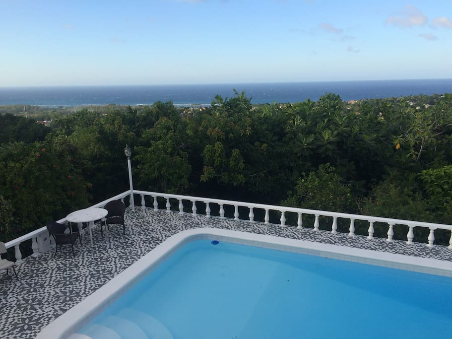Amazing view of the Caribbean ocean nestled on a tranquil private property with large pool, an amazing back yard with a variety of tropical fruits and perfect for barbecuing some jerk chicken and having a red stripe beer.