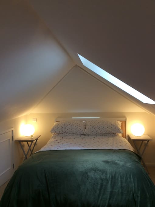 Comfortable double bed. No blind on the skylight.