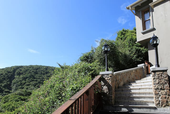 Steps towards the front door... stairway to heaven. To get the magic seaviews you need to climb the stairs.