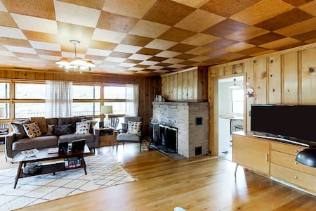 Stylish home w/ '60s flair, a wraparound porch, home comforts & a great location