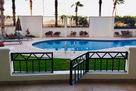 1 block to beach, pool facing terrace, lower level
