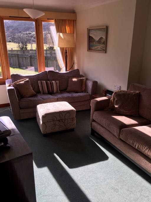 """Our small but comfortable lounge with Sky TV, 42"""" plasma TV and BlueRay/DVD player."""
