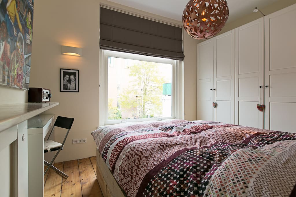 The master bedroom with king-size bed (and make-up table)