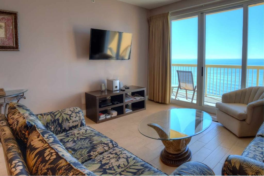 Spacious and sunny Living Area!  Includes balcony access and a queen sleeper sofa!