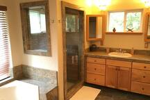 Master bathroom with enclosed shower and jet tub