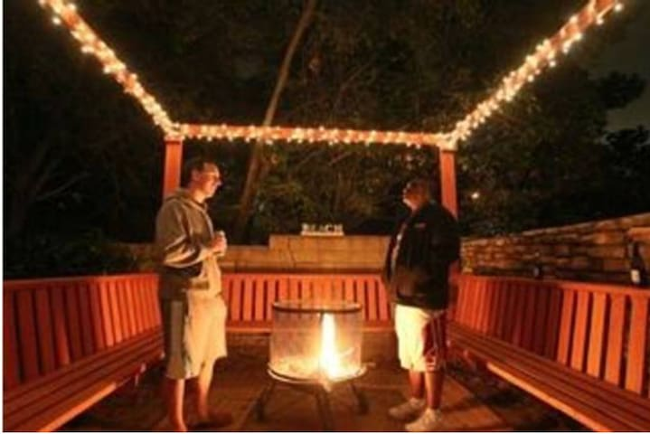 Enjoy this fire pit area. 2 fire logs will be included with your Movie night or backyard venue booking!