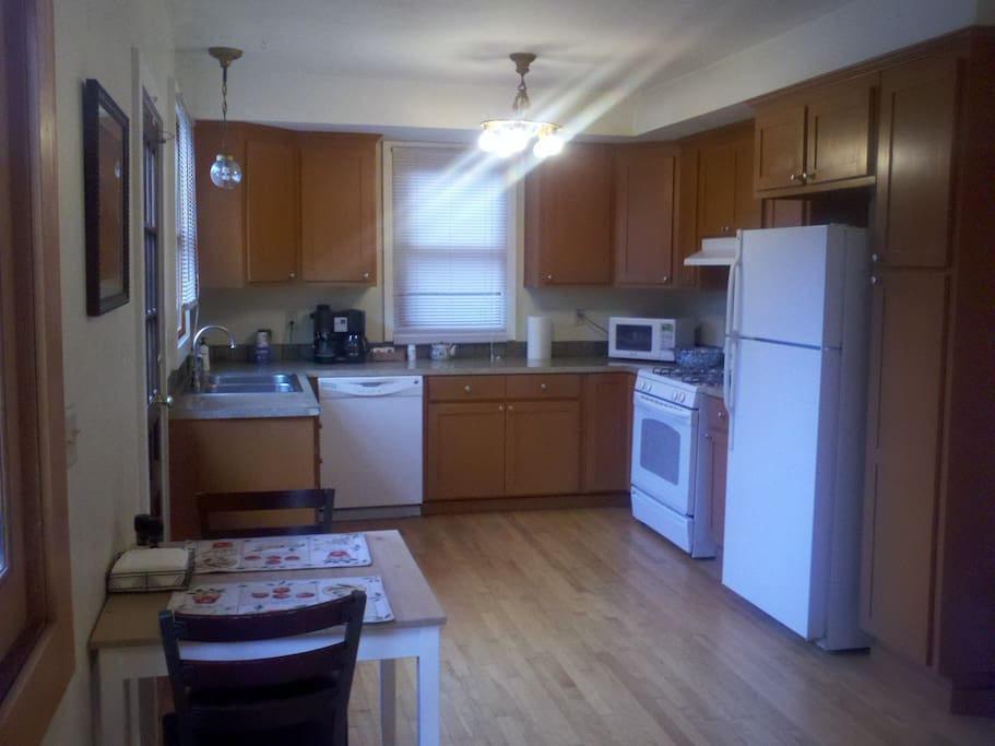 Fully equipped shared kitchen shared by 4 suites