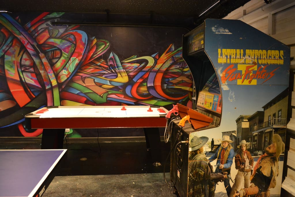 The games room, a shoot em arcade game, Air hockey, Ping Pong and 2 side by side race car simulators