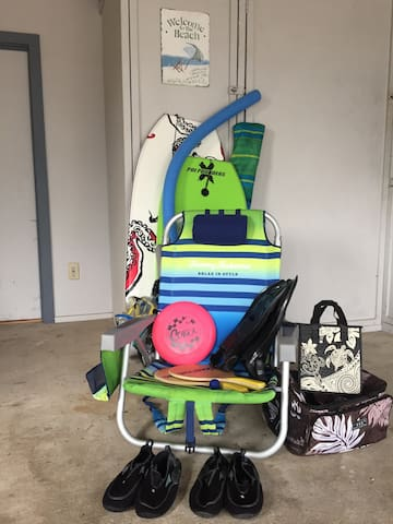 Beach Gear - includes Beach games, Tommy Bahama beach chairs, different coolers, Tommy Bahamas Beach Umbrella, boogie boards and assorted snorkeling gear.