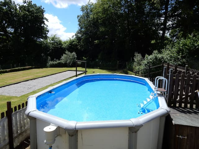 Wonderful grounds of over an acre complete with above ground, fully fenced and padlocked pool as well as boule pitch and games room.